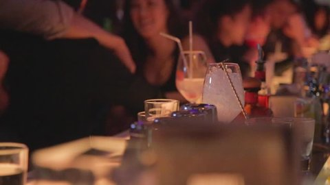 TAIPEI,TAIWAN - CIRCA October 2013 :cinematic dolly shot of bartender mixing a drink