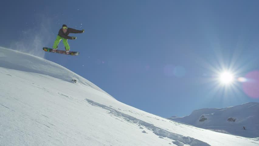 SLOW MOTION: Snowboarder jumps backflip in powder #8055223