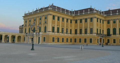 Pan right motion video of Schonbrunn Palace building, famous baroque architecture, summer tourism travel landmark in Vienna city park at sunset, Austria, Europe. Old imperial residence castle in Wien.