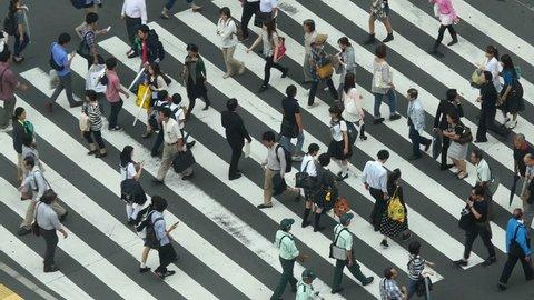 Tokyo Japan - Circa September 2014 Busy Pedestrian Street Crossing From Above  - Shibuya, Tokyo Japan - Circa September 2014