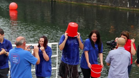 SALFORD QUAYS, UK. 5 SEPTEMBER 2014. Staff from Auto Trader magazine and  website undertake the Ice Bucket challenge  on Salford Quays to raise funds for the Motor Neurone Disease Association.