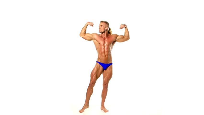 Bodybuilder posing over white background.