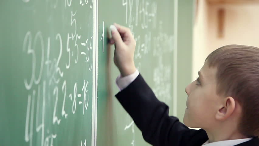 Schoolboy solves math on the school blackboard 3 | Shutterstock HD Video #8082232