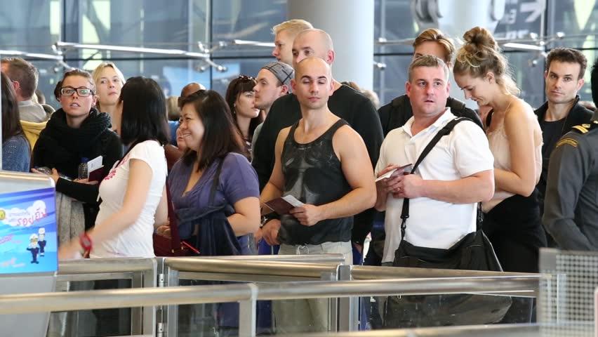 BANGKOK, THAILAND - NOVEMBER 14, 2014: Airport passport control. People get there passports checked at Suvarnabhumi Airport