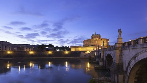 4K Time lapse zoom out Castel Sant Angelo and the Sant Angelo bridge in Rome from twilight illuminated by night. Also known as the Mausoleum of Hadrian.