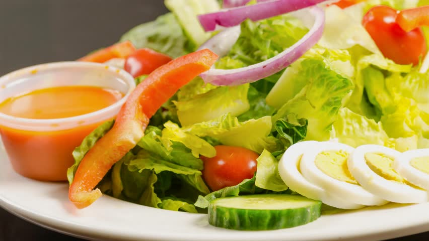 delicious garden salad served in stock footage video 100 royalty free 8150893 shutterstock - Delicious Garden