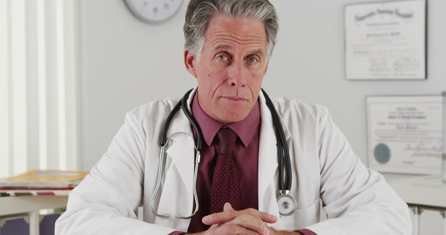 Senior doctor talking to camera | Shutterstock HD Video #8178583