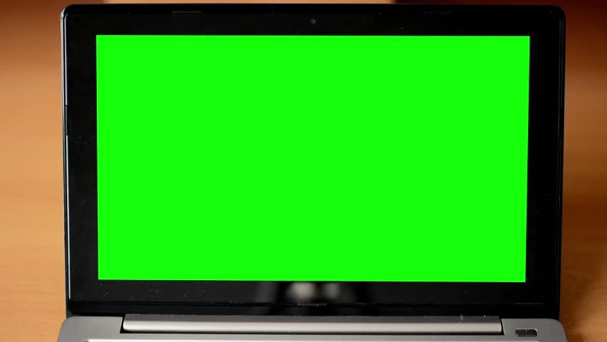 Notebook monitor green screen - table - closeup | Shutterstock HD Video #8219323