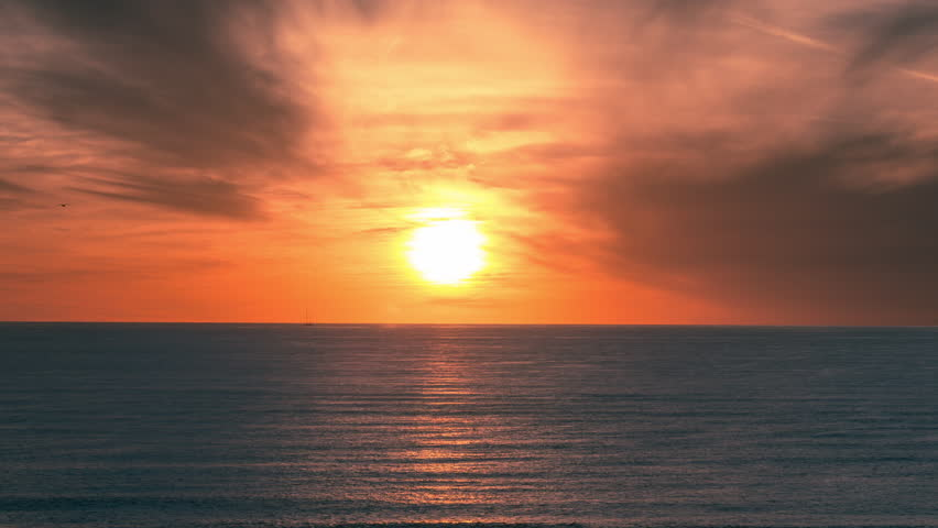 Beautiful Orange Sunset on Ocean - Timelapse of Colorful Sky and Sun Setting on Water in 4K | Shutterstock HD Video #8259163
