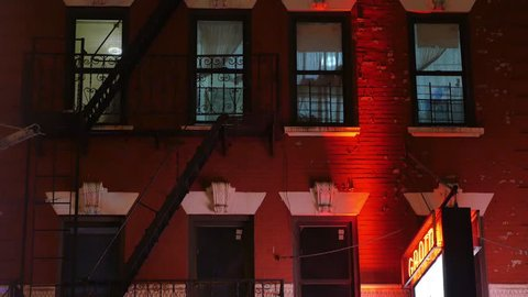 A typical New York City apartment building establishing shot in the night.