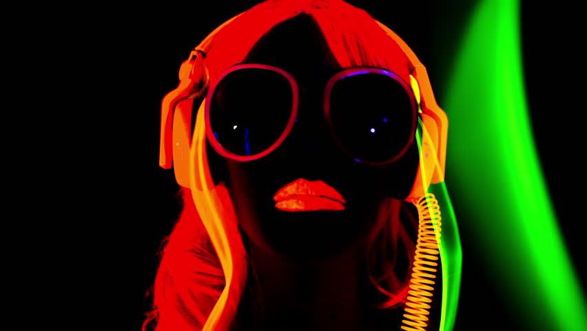 4k fantastic video of sexy cyber raver dancer babe filmed in fluorescent clothing under UV black light