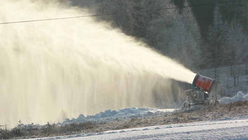 Snow cannon manufactures and snowcat smoothes, artificial snow on piste in the ski resort #8296993
