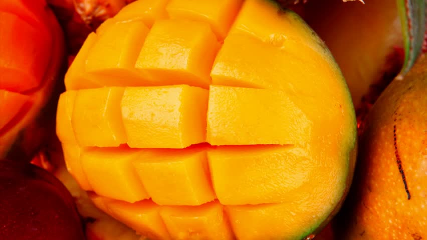 diet food - set of lot of tropical fruits include pineapple plum and mango in orange colander 1920x1080 intro motion slow hidef hd