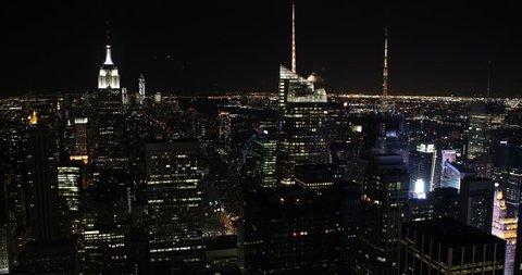Establishing Shot Evening Lit Aerial View New York City Manhattan Cityscape Financial District ( Ultra High Definition, UltraHD, Ultra HD, UHD, 4K, 2160P, 4096x2160 )