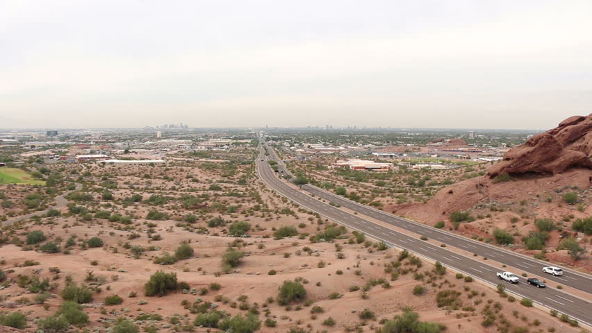 PHOENIX, ARIZONA - NOV 12, 2014: Phoenix, Arizona and the surrounding area on a hazy day. East McDowell Road in the foreground. | Shutterstock HD Video #8333203