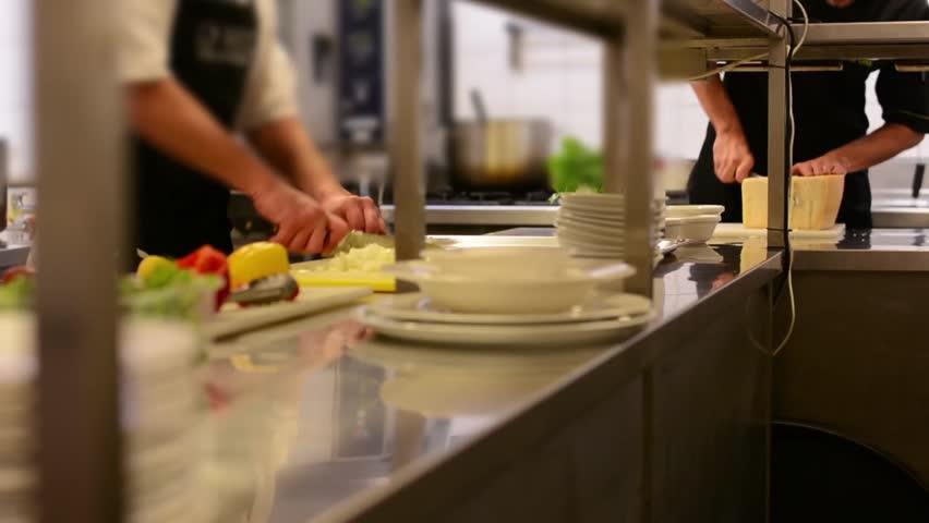 Chefs cook in the kitchen - restaurant   Shutterstock HD Video #8340259