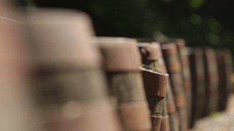 Slider shot of old rustic whisky barrels outside