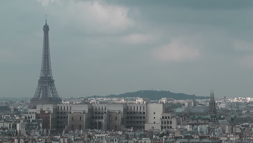 Eiffel tower and Paris roofs. Overcast sky. Paris, France, Europe | Shutterstock HD Video #837133