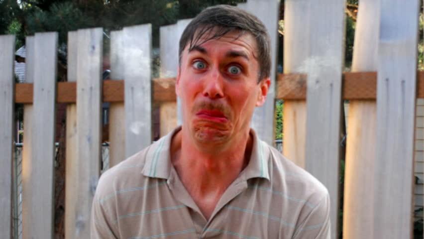 Man eats hot pepper and blows fire