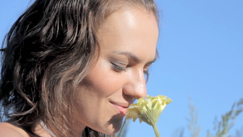 Woman smelling flower - 1080p