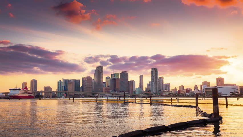 Miami skyline at sunset with clouds passing by