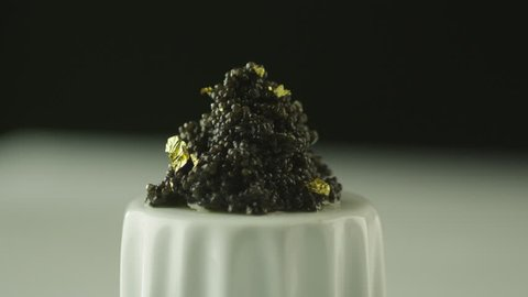 Professional Cook Garnish Black Caviar with Gold in Luxury Restaurant. Shot on RED Cinema Camera in 4K (UHD). ProRes codec - Great for editing, color correction and grading.