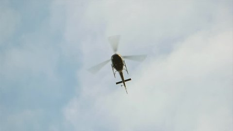 helicopter flying background. slow motion. chopper in flight. aircraft airborne