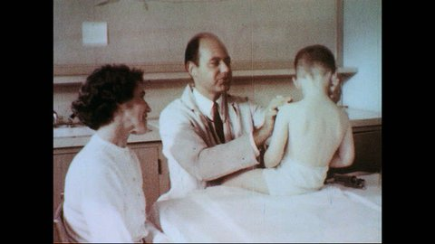 UNITED STATES 1950s-1960s : A doctor examines a boy as children learn in a special classroom and a man gets a chest x-ray.