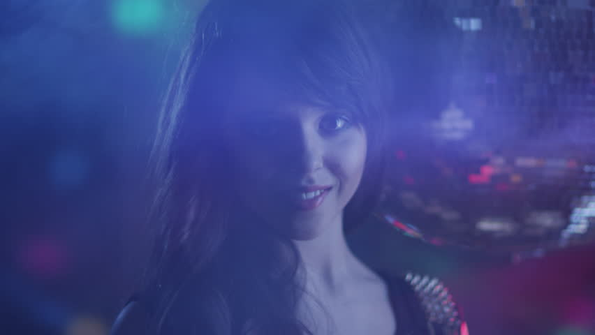 Teen Brunette Girl is Smiling in Nightclub. Shot on RED Cinema Camera in 4K. Its easy scale, rotate and crop without loosing quality. ProRes codec  - Great for editing, color correction and grading. #8478013