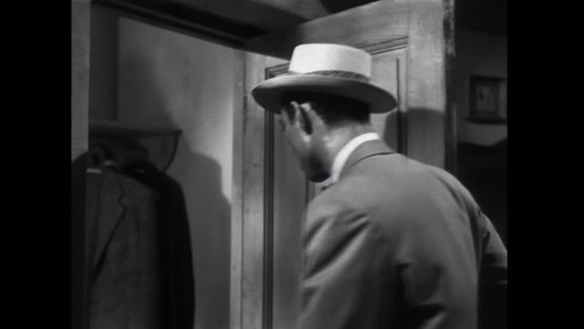 Man searching through jacket pockets in closet | Shutterstock HD Video #8488123