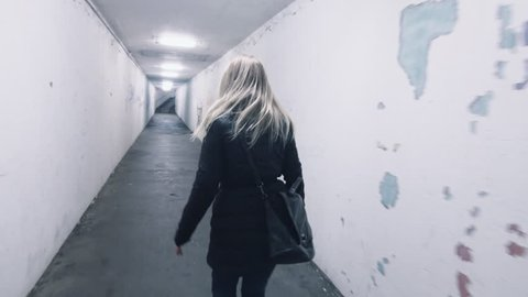 frightened scared woman in panic runs away from murdered mugger rapist bad man back view horror dark mood uhd 4k