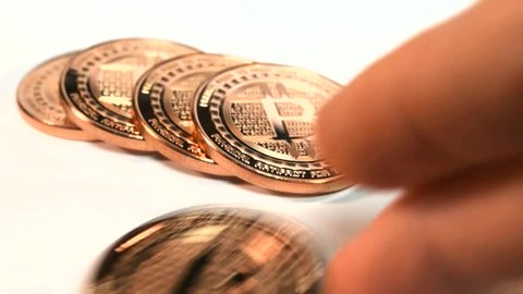 Money Finance E-Commerce Bitcoin Online Payments Virtual Currency financial concept of cashing in a Bitcoin payment visualized using shiny copper rounds as bitcoins - isolated.