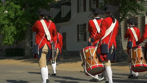 Colonial Military Marching band in Williamsburg Virginia in Super Slow motion. Full HD stock video clip.