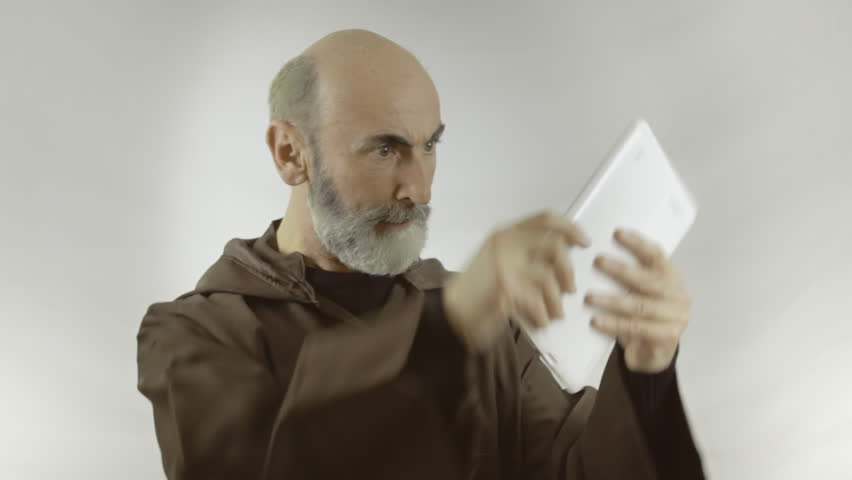 A friar franciscan religious man unable to understand how a a friar franciscan religious man unable to understand how a tablet pc works nobody can help him hes getting upset medium shot white background voltagebd Choice Image