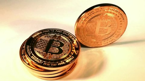 Cashing in a Bitcoin payment, using Crypto coins, online virtual currency payments visualized using stack of shiny copper rounds as bitcoins, isolated.