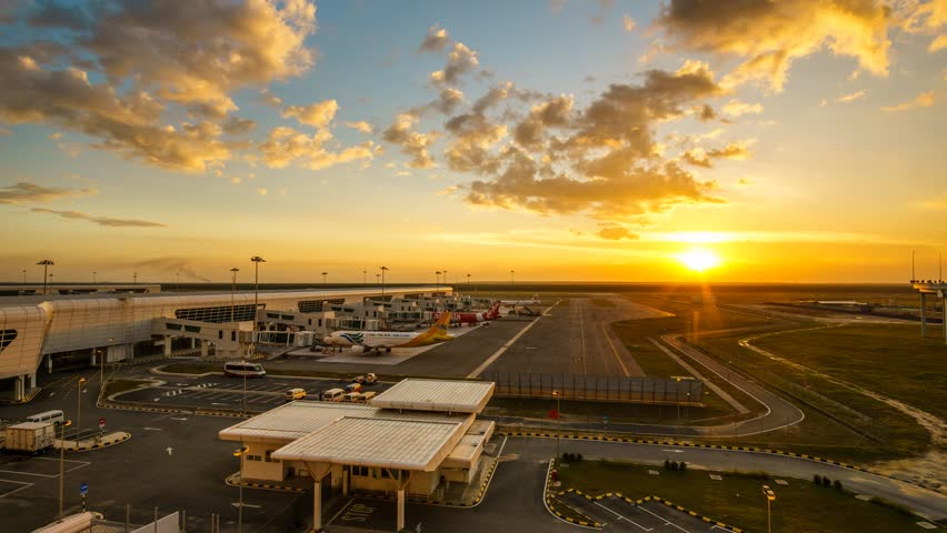 KUALA LUMPUR - JANUARY 2015 : Aeroplanes taxiing to terminal at  Kuala Lumpur International Airport 2 (KLIA2), Kuala Lumpur, Malaysia during sunset. Timelapse