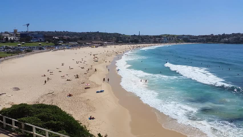 BONDI BEACH, SYDNEY, AUSTRALIA - JANUARY 22, 2015: Bondi Beach or Bondi Bay is a popular beach on a hot summers in Sydney.