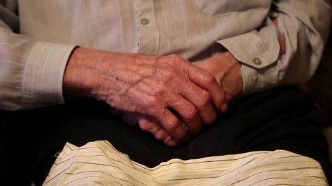 Hands of 93-year old man after two cerebral strokes