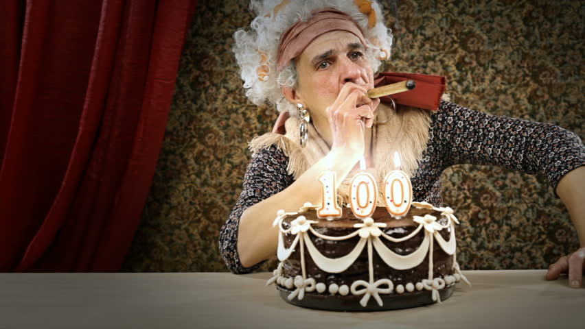Funny senior woman is celebrating her birtHDay smoking a cigar - HD video footage
