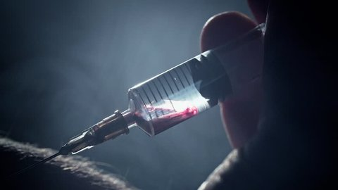 Male addict injects a syringe into a vein. Takes a blood sample. Heroin or meth. Social degradation, self-destruction of narcomaniac junkie. Real blood clip footage.