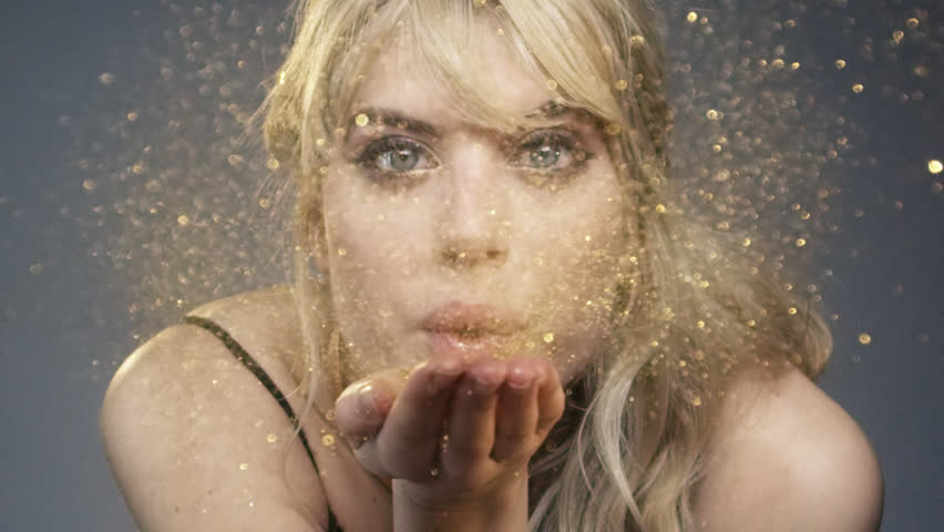 Beautiful woman blowing gold glitter slow motion - Red Epic Dragon