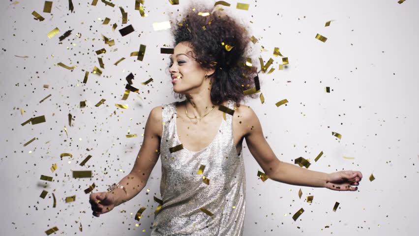 Beautiful hispanic woman dancing throwing gold confetti slow motion - Red Epic Dragon