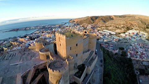 Muslim and Christian fortress in Almeria - Alcazaba. 4k Ultra High Resolution Aerial footage during sunset. flying over the spanish old town costa blanca, andalusia