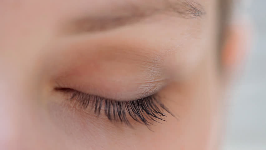 Close up detail view of a young caucasian woman eye looking at the camera and blinking slowly. Eyes and vision well being and healthy eye sight. Attractive woman with blue green eyes. | Shutterstock HD Video #8839033