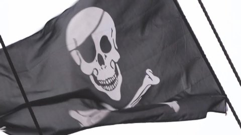 Classic skull and crossbones flag flapping in the wind.