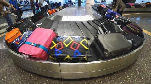 BANGKOK, THAILAND - FEBRUARY 08, 2015: Baggage conveyor belt in the Suvarnabhumi Airport carrying the passenger luggage.