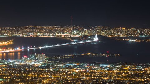 Time lapse of san francisco and other parts of the bay area including the  new span of the bay bridge, shot from a high vantage point in the berkeley  hills  camera zooms out  4k version also available