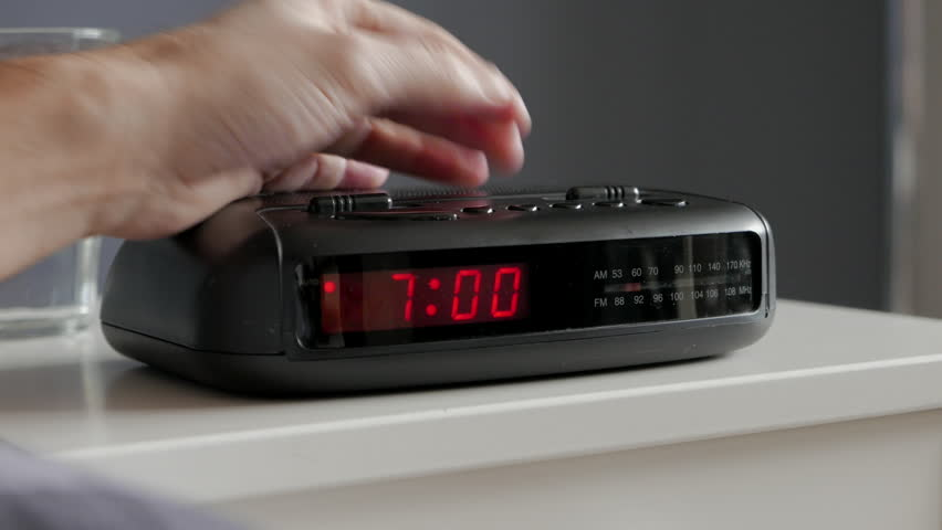 Alarm clock digital ringing, 7am, tired man pushes if of bed table #8894296