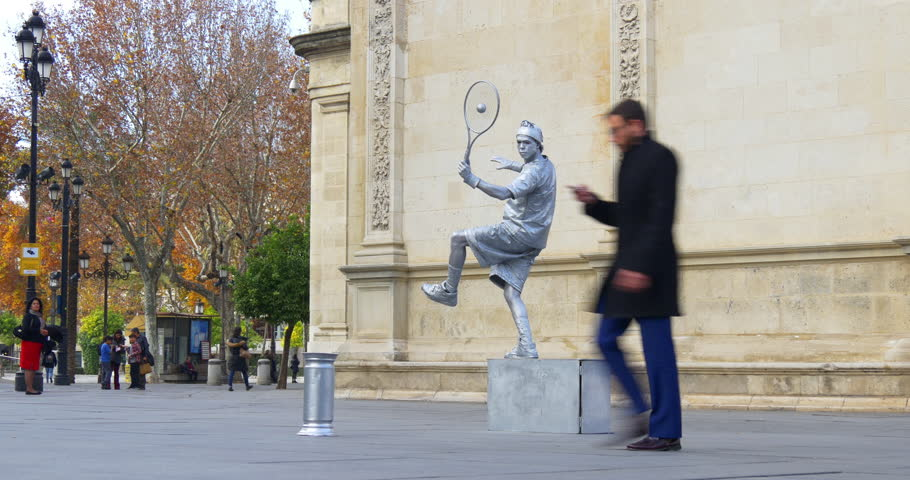 SEVILLE, SPAIN - JANUARY 2015: tourist place living statue of tennis player in square 4k circa january 2015 seville, spain | Shutterstock HD Video #8916703