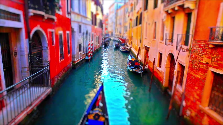 Romantic tour in gondola, rowed by a gondolier in the venice canal.tilt shift